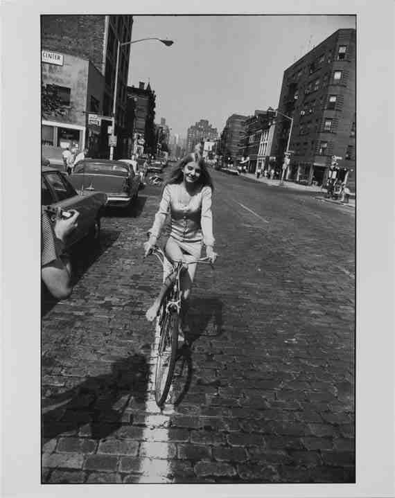 Garry Winogrand: Woman Riding Bicycle