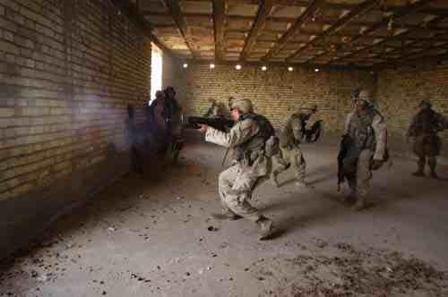 Falluja: Marine fires a grenade at insurgent positions