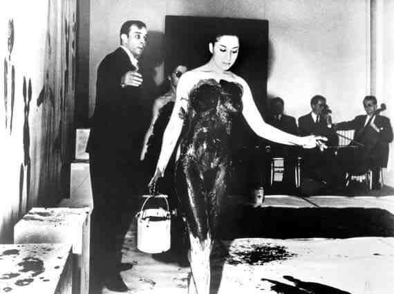 Yves Klein and a model during the performance
