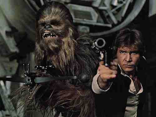 Peter Mayhew and Harrison Ford as Chewbacca and Han Solo