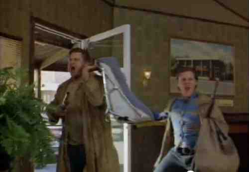 John Goodman and William Forsythe rob a bank in Raising Arizona