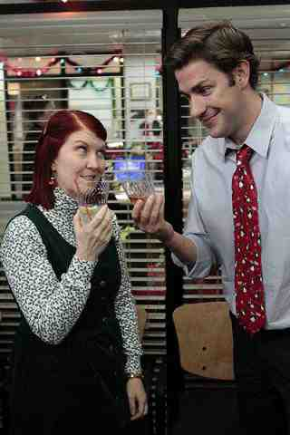 Kate Flannery as Meredith Palmer, John Krasinski as Jim Halpert in The Office Christmas Wishes