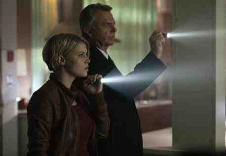 Sarah Jones as Madsen and Sam Neill as Hauser in Alcatraz' Johnny McKee