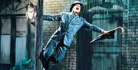 Gene Kelly stars in and co-directs Singin' In The Rain